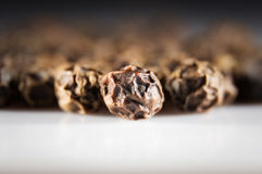 Pepper spice macro. Brown pepper corn spice extreme macro photohraphy Royalty Free Stock Photo