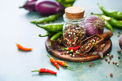 Pepper spice mix and hot pepper in pods. Ingredients for cooking. Selective focus Royalty Free Stock Image