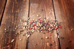 Pepper spice on wood table Stock Photos