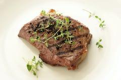 Pepper steak with organic greek basil Royalty Free Stock Photography