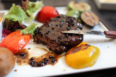 Pepper steak on plate Royalty Free Stock Photo