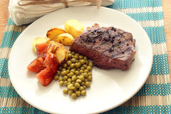 Pepper steak with roasted potato Stock Photo