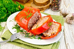 Pepper stuffed meat in plate on board Royalty Free Stock Photo
