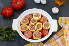 Pepper stuffed with minced meat and rice in a ceramic form royalty free stock photography