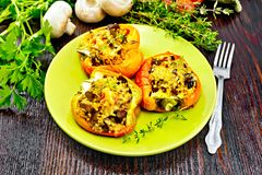 Pepper stuffed with mushrooms and couscous in green plate royalty free stock photography