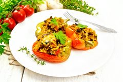 Pepper stuffed with mushrooms and couscous in white plate on tab royalty free stock photo