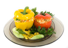 Pepper and tomato. Yellow pepper and red tomato stuffed with vegetable salad Stock Images