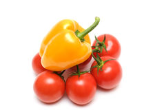 Pepper and tomatoes. Yellow pepper and red tomatoes isolated on white background Stock Images