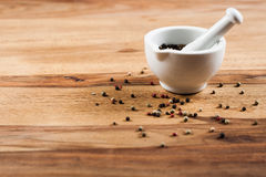 Pepper on wood tabel. Pepper on wood table with white mortar Stock Photo