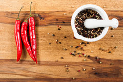 Pepper on wood tabel. Pepper on wood table with white mortar Stock Photos