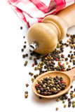 Pepper and wooden pepper mill Royalty Free Stock Image