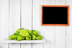 Pepper on a wooden shelf. Stock Images