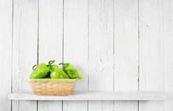 Pepper on a wooden shelf. Royalty Free Stock Photography