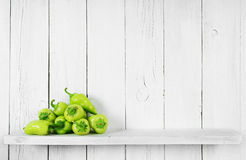 Pepper on a wooden shelf. Royalty Free Stock Photo