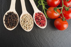 Pepper in wooden spoon Stock Images