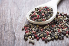Pepper in wooden spoon Stock Photos