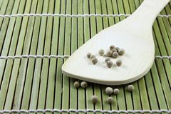 Pepper and wooden ware Stock Photos