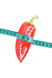 Pepper wrapped with measuring tape Royalty Free Stock Photography