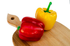Pepper yellow and red on a board Stock Image