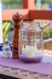 Pepperbox, abanador de sal e vela Imagem de Stock