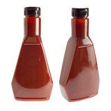 Peppercorn barbecue sauce on white. Generic bottle of spicy barbecue sauce / ketchup - two angles Royalty Free Stock Photography