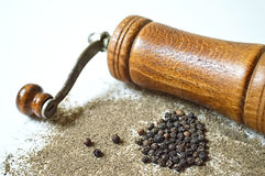 Peppercorn, grinder and grounded pepper Royalty Free Stock Photo