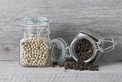 Peppercorn jars on shelf Stock Images