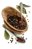 Peppercorn mix in a bowl and bay leaves Royalty Free Stock Images