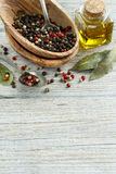 Peppercorn mix in a bowl, bay leaves  and olive oil Royalty Free Stock Images