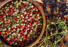 Peppercorn mix in wooden bowl, herbs and spices Royalty Free Stock Photos