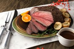 Roast Beef Rustic Style. Peppercorn roast beef with herbed Yorkshire puddings and gravy Royalty Free Stock Image
