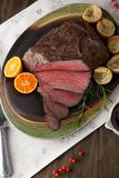 Roast Beef Rustic Style. Peppercorn roast beef with herbed Yorkshire puddings and gravy Royalty Free Stock Photography
