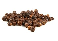 Peppercorns. Closeup of black peppercorns, isolated on white royalty free stock photo