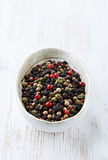 Peppercorns. Assorted peppercorns in a dish royalty free stock photography