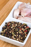 Peppercorns And Garlic Stock Photography