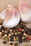 Peppercorns And Garlic Royalty Free Stock Image