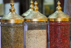 Peppercorns in ornate jars Stock Photo
