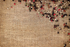Peppercorns over hessian canvas Royalty Free Stock Photo