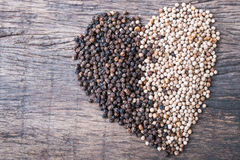Peppercorns in shape of heart Stock Photo