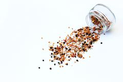 Peppercorns spilled on a white background royalty free stock photo
