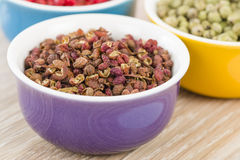 Peppercorns. Szechuan, green and pink dried royalty free stock images