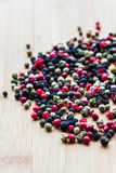 Peppercorns. Three colored peppercorns for cooking Stock Images