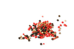 Peppercorns of three varieties. Isolated on white Stock Images