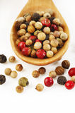 Peppercorns on wood spoon Royalty Free Stock Photos