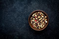 Peppercorns in a wooden bowl Stock Photos