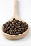 Peppercorns on wooden spoon Royalty Free Stock Photography
