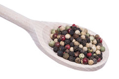 Peppercorns on a wooden spoon Royalty Free Stock Photography