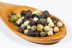 Peppercorns in a wooden spoon Stock Photo