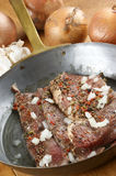 Peppered beef steak in a brass pan Royalty Free Stock Photography