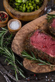 Peppered beef steak with herbs in vintage kitchen Stock Image